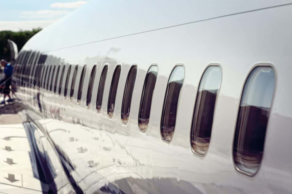 Airplane windows disembarking after arrival at vacation airport